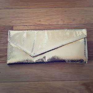 Bright shiny gold Deena & Ozzy envelope clutch